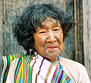 Traditional Dulong Woman with a tattooed face